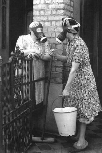 Housewives wearing gas masks during the Blitz on London showed the country's stubborn resistance, ca. 1940s